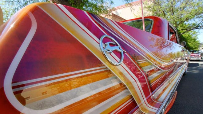 This May 22, 2016 photo shows the stylized quarter panel of a 1963 Chevrolet Impala on display at the historic plaza in Santa Fe, as part of the city's Lowrider Summer celebration. The New Mexico History Museum and the New Mexico Museum of Art also are hosting exhibitions highlighting the lowrider culture.