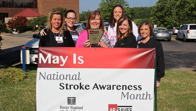 Kelly Dicks, MSN, RN, BRMC Cline Emergency Center Director (center), with fellow staff members and the AR SAVES Site Excellence Award.