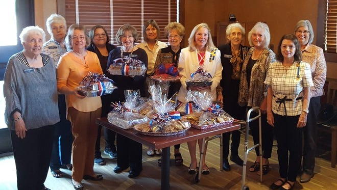 Members of the Captain Nathan Watkins Chapter of the Daughters of the American Revolution recently baked and delivered over 25 dozen cookies to the police, fire and sheriff's departments, thanking them for the vital services they provide to their communities. Partcipating were: (first row, from left) JoBelle Zimmerman, Janet Emery, Susan Allen, Charlotte Barnhart, Caroline Carroll, Dianne Freeman, Kathy Bauwens, (second row)Jo Anne Dukes, Rita Barker, Sally Soderblom, Maralou Spear and Carol Adams.