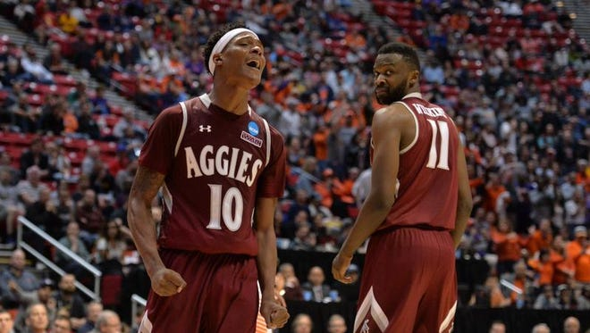 Mar 16, 2018; San Diego, CA, United States; New Mexico State Aggies forward Jemerrio Jones (10) and forward Johnathon Wilkins (11) react against the Clemson Tigers during the second half of the first round of the 2018 NCAA Tournament at Viejas Arena.
