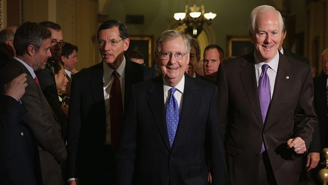 Senate Majority Leader Mitch McConnell, R-Ky., center, Majority Whip John Cornyn, R-Texas, right, and Republican Policy Committee Chairman John Barrasso, R-Wyo., left,.