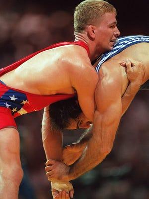 USA's Les Gutches, left, grapples with Kazakstan's Elmadi Jabrailov during their 82kg class quarterfinal freestyle wrestling match July 30, 1996 at the Centennial Summer Games in Atlanta. Jabrailov won the match. (AP Photo/Michel Lipchitz)