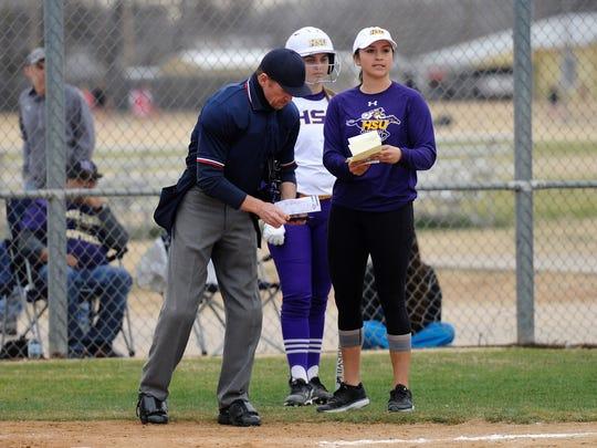 Hardin-Simmons coach Chanin Naudin talks with the home