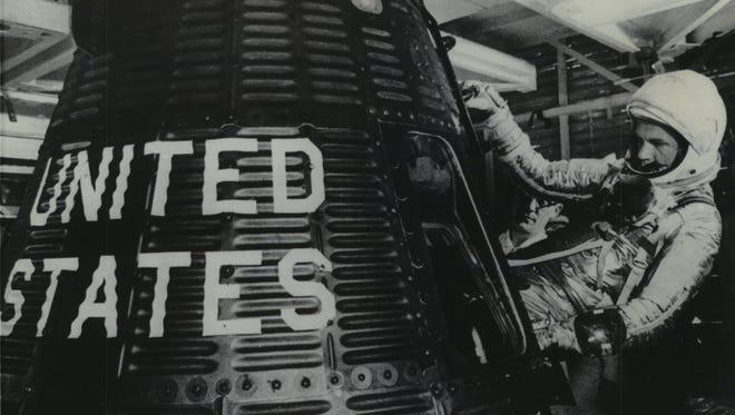 Astronaut John Glenn climbs into the Friendship Mercury capsule at Cape Canaveral, Fla., on Feb. 20, 1962.
