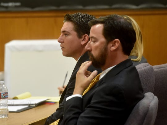 Kevin Hogrefe, of Camarillo, and his defense team listen