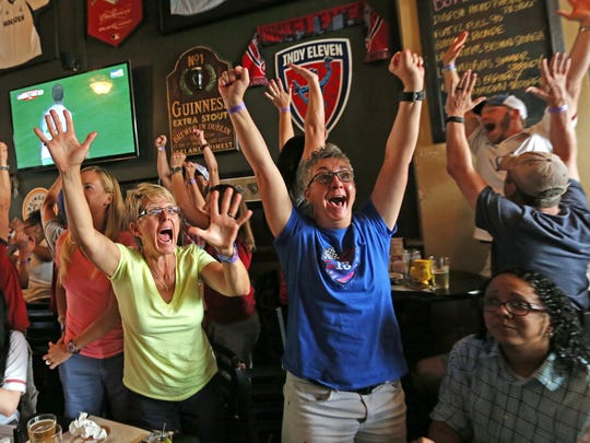 April Hicks, Patty Heffelman and others get loud at  Chatham Tap on Mass Ave after the U.S. scores in the 2015 World Cup finals.