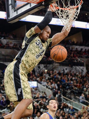 San Antonio Spurs forward David West dunks during the second half of an NBA basketball game against the Charlotte Hornets, Saturday, Nov. 7, 2015, in San Antonio. San Antonio won 114-94. (AP Photo/Darren Abate)