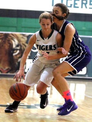 Monroe's Ashlyn Petersen tries to block South Plainfield's Caity Hughes on Jan. 22,2015 at South Plainfield.