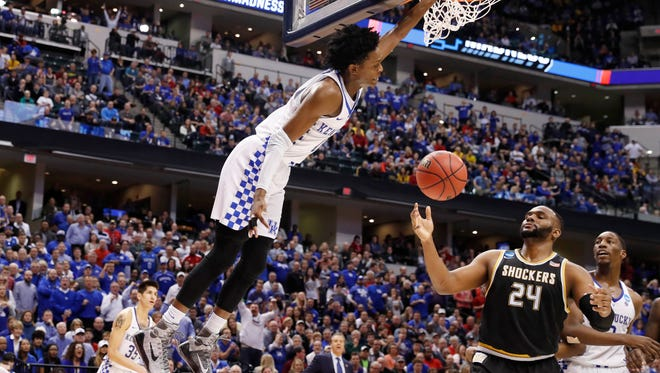 Kentucky Wildcats guard De'Aaron Fox (0) dunks against the Wichita State Shockers during the second half in the second round of the 2017 NCAA Tournament at Bankers Life Fieldhouse on March 19.
