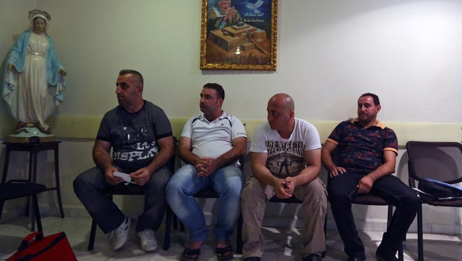 Iraq Christians who fled their home with their family from Iraq wait at the Chaldean Diocese in Baabda, east of Beirut, Lebanon, to have their names registered in order to get aid. Thousands of Christians have fled their homes in Iraq after they were made to choose between leaving, converting to Islam or facing death.