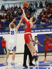 Tipping it up on Friday are Salem's Matt Jira (21) and Canton's Chase Meredith (30).