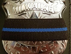 Public officials offer their condolences after a Milwaukee police officer is fatally shot