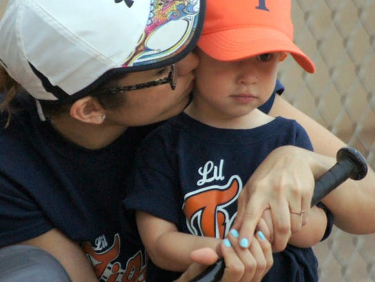 Two-year-old Li'l Tigers slugger Eli Ramirez listens