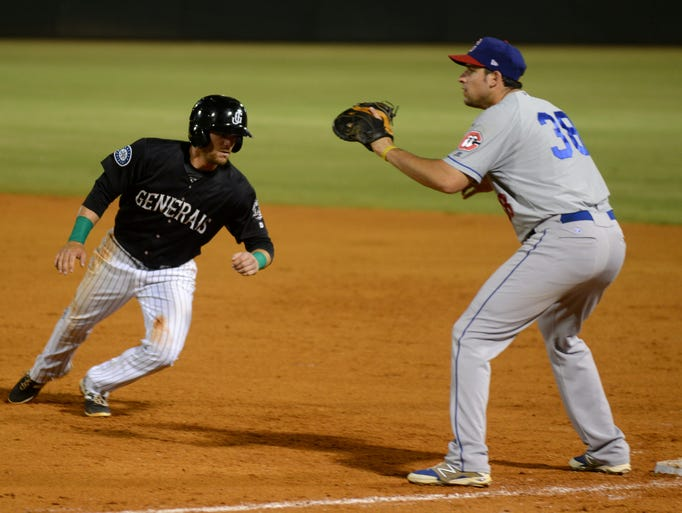 Tyler Smith (left) of the Jackson Generals slides into first base while Alex Liddi of the Chattanooga Lookouts waits to catch.