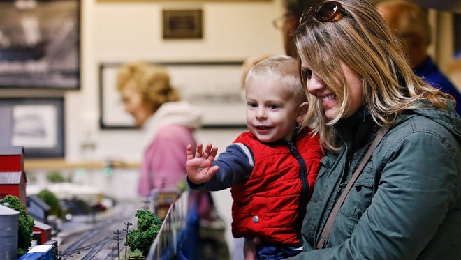Sylas Oakley and Leslie Price enjoying the Battle Creek Model Railroad Club's contribution to Fall into The Arts. The two are new to the Battle Creek area.