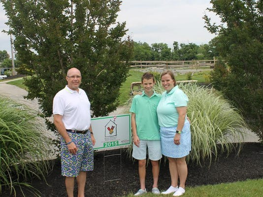 From left are Steve, Aaron and Christina Lesher.