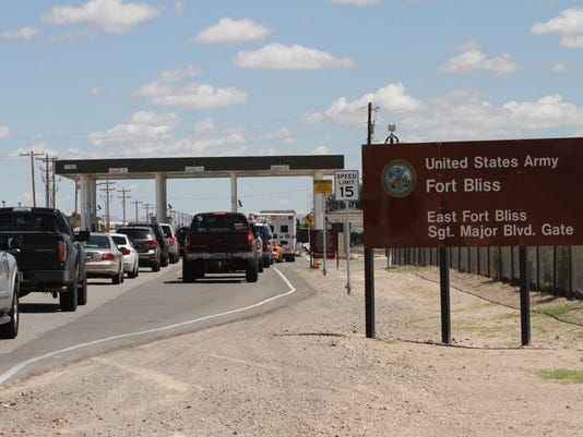 Cars wait to enter Fort Bliss in El Paso, Texas, on Tuesday Sept. 9, 2014.