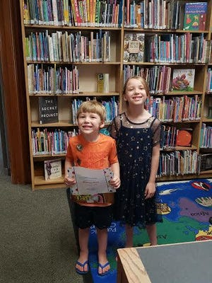 Monroe Rice (left) and his sister, Addy Rice, pose for a photo. Monroe joined Addy in the 1,000 Books Before Kindergarten Club at the Ionia Community Library.