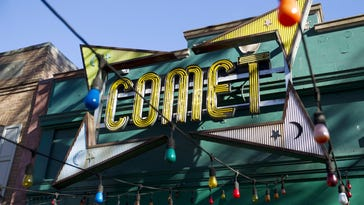 "The front door of Comet Ping Pong pizza shop, in Washington. A fake news story prompted a man to fire a rifle inside a popular Washington, D.C., pizza place as he attempted to ""self-investigate"" a conspiracy theory that Hillary Clinton was running a child sex ring from there, police said."