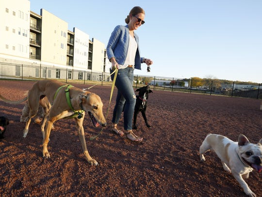 Rebekah Mabrey takes her 4-year-old greyhound Otis to the dog park at the Cityville apartments in Des Moines last fall.