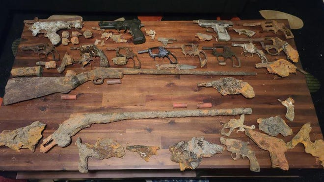 These guns were found in Athens at the bottom of the North Oconee River at the College Avenue bridge by the Cowart brothers.