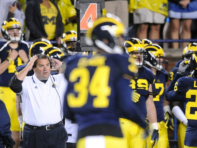 Michigan Wolverines head coach Brady Hoke adjusts a headset on the sidelines in the fourth quarter of a 26-10 loss to Utah at Michigan Stadium on Saturday, September 20, 2014.