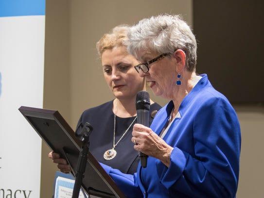 Pensacola City Councilwoman Sherri Myers reads a city