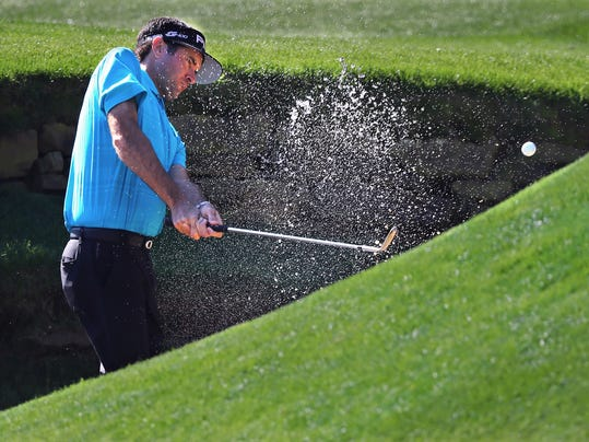 Bubba Watson chips from the creek to the 13th green during a practice round for the Masters golf tournament at Augusta National Golf Club in Augusta, Ga., Monday, April 2, 2018. (Curtis Compton/Atlanta Journal-Constitution via AP)