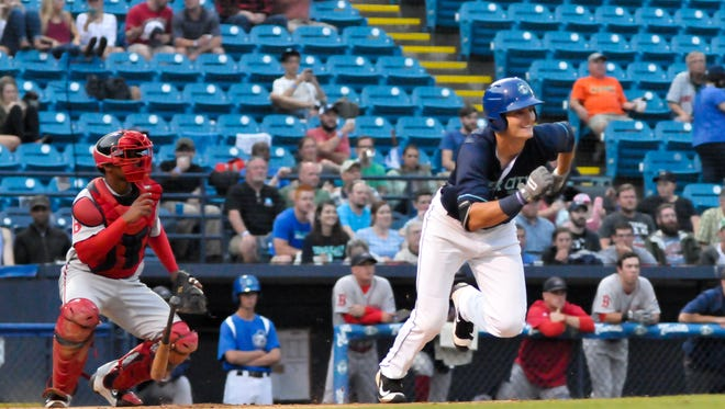 Sam Hilliard of the Asheville Tourists heads for first base during a recent home game against the Greenville (S.C.) Drive.