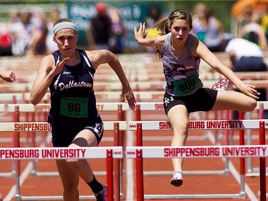 Dallastown's Sally Trout competes against South Western's Steph Shaw in the girls' AAA 100 meter hurdles on Friday at the PIAA District 3 Track and Field Championships at Shippensburg University. (The Evening Sun -- Shane Dunlap)