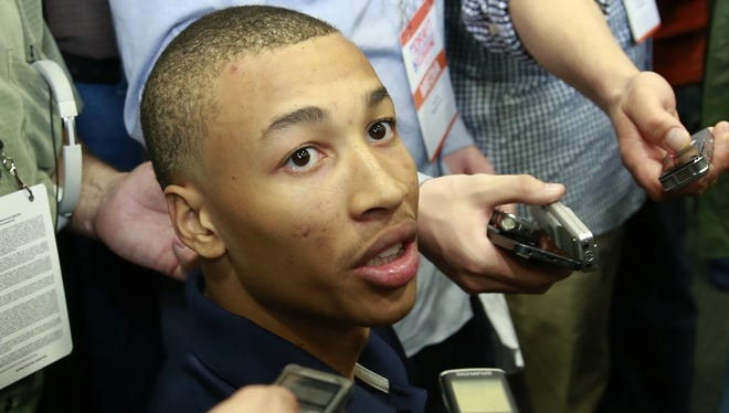 Dante Exum from Australia meets with reporters at the 2014 NBA basketball Draft Combine.