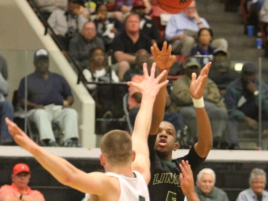 Lincoln's Tionne Rollins fires a 3-pointer during Saturday