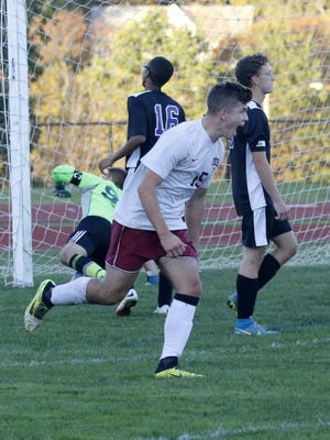 Taylor Grover celebrates after scoring one of his three goals Wednesday in Odessa-Montour's 8-0 win over Spencer-Van Etten/Candor in the Section 4 Class C boys soccer tournament in Odessa.