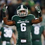Former Detroit Renaissance High and Michigan State football player Mylan Hicks was killed in Canada, according to reports.