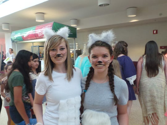 Fans dress as Taylor Swift's cats at the concert.