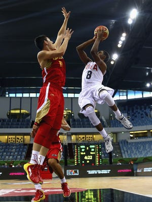 DUBAI, UNITED ARAB EMIRATES - AUGUST 14:  VJ King of the United States shoots against Hao Fu of China during the FIBA U17 World Championships Quarter-Final match between China and the United States of America  at the Hamdan Sports Complex    on August 14, 2014 in Dubai, United Arab Emirates.  (Photo by Francois Nel/Getty Images)