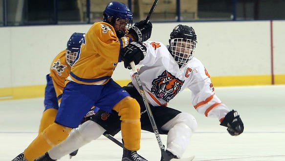 From left, Mahopac's John Dignam (16) and White Plains'