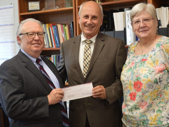 Accepting a donation from Roselle Savings Bank are