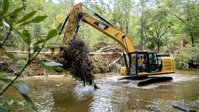 A crew from North State Environmental uses excavators to move trees and dirt from the riverbank of the Davidson River downstream from the Setzer State Fish Hatchery in the Pisgah National Forest on Aug. 5. The project is a partnership between two chapters of the conservation group Trout Unlimited and the North Carolina Wildlife Resources Commission to improve the section of river.