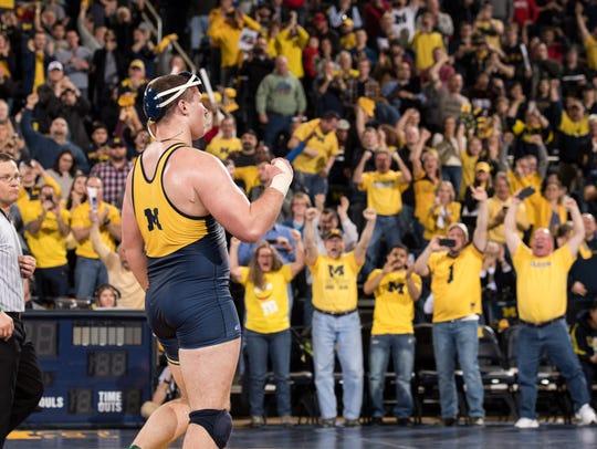 Michigan's Adam Coon, a Fowlerville graduate, celebrates