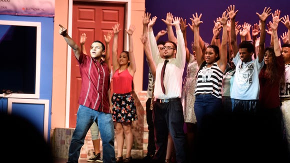 "William Penn student Augustine Mariche, far left, performs as the character Usnavi in William Penn's production of Lin-Manuel Miranda's ""In the Heights"" Saturday, April 9, 2016, at the Strand-Capitol Performing Arts Center."