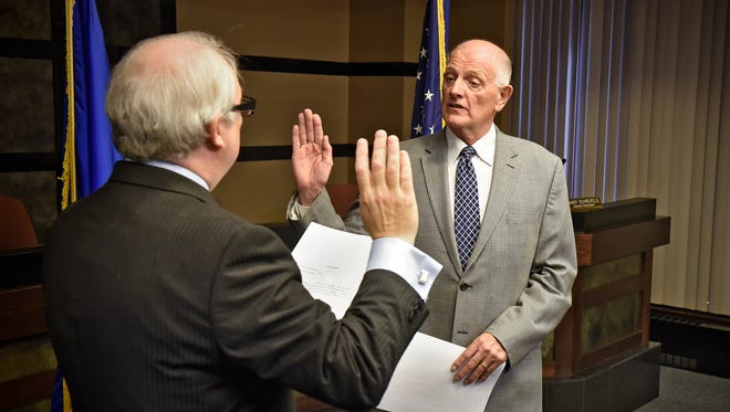 Stearns County Court Administrator George Loch leads a swearing-in ceremony for Stearns County Sheriff Don Gudmundson during a ceremony Wednesday, May 24, at the Stearns County Administration Center in St. Cloud.