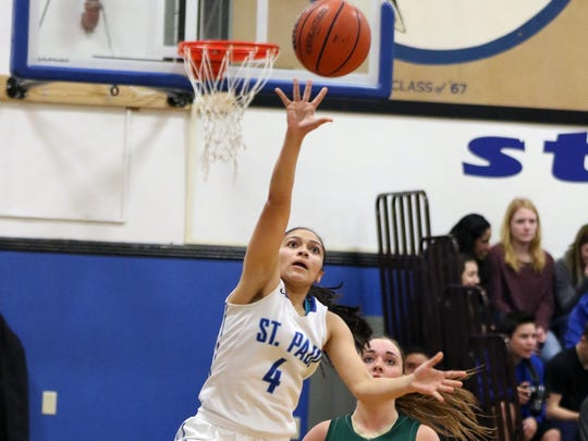 St. Paul's Griselda Vargas-Ayala and the Buckaross fall to St. Paul in a Tri-River Conference game on Friday, Jan. 15, 2016, in St. Paul.