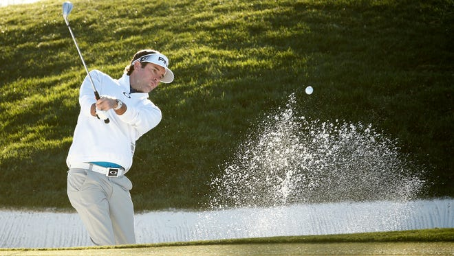 Bubba Watson blasts out of a bunker on the 12th hole during the second round of the Waste Management Phoenix Open at TPC Scottsdale in Scottsdale on Feb. 5, 2016.