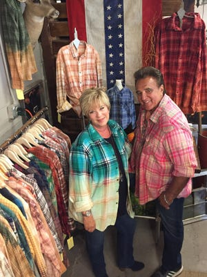 Cindy Laverty and Dominic Gironda at The Barn Door in Franklin stand amid a display of their Franklin Flannels merchandise.