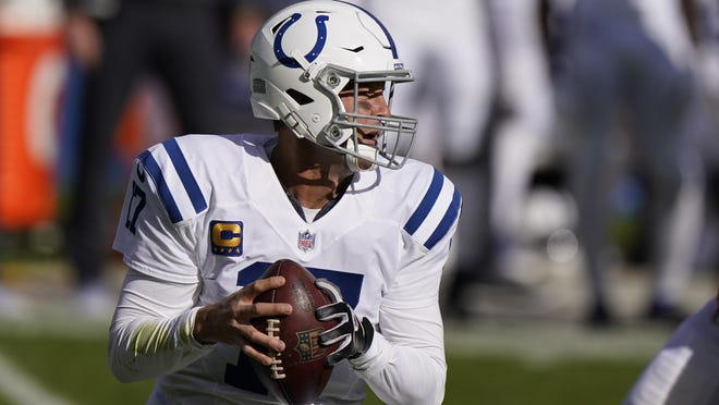 Indianapolis Colts quarterback Philip Rivers (17) looks to throw during the first half of an NFL football game against the Chicago Bears, Sunday, Oct. 4, 2020, in Chicago.