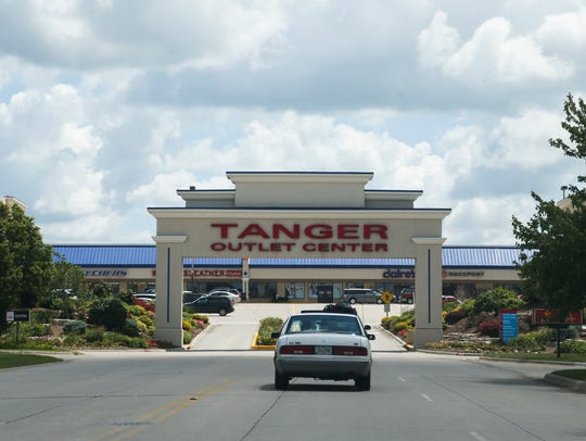 Motorists stop at the Tanger Outlet Mall along Interstate