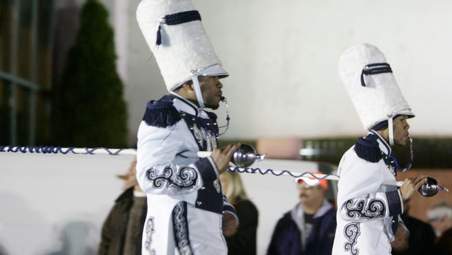 """""""Aristocrat of Bands"""" drum majors Larry Jenkins (left) and Daniel Hayes lead Tennessee State University's marching band in the Nashville Christmas Parade in Nashville, Tenn. on Friday, December 5, 2008."""