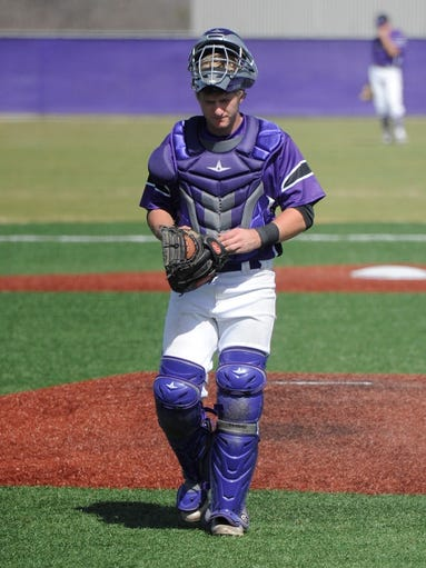 Wylie catcher Caleb Munton (25) walks back to the plate