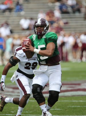 Mississippi State quarterback Dak Prescott looks for a receiver in the spring football game on April 12, 2014 at Davis Wade Stadium in Starkville. (Photo by Kevin Warren)